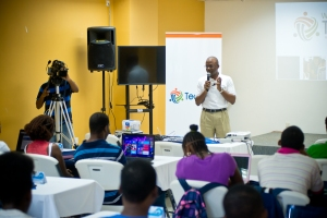 Bevil Wooding, Founder and Executive Director of BrightPath Foundation, conducts a workshop with young participants at the launch of TechLink in St George's, Grenada on November 30. Photo courtesy Relate Studios.