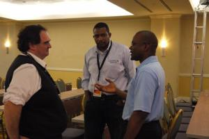 From left, Carlos Martinez, chief technology officer of the the Latin American and Caribbean Internet Addresses Registry (Lacnic), Stephen Lee, programme manager of the Caribbean Network Operators Group (Caribnog) and Bevil Wooding, Caribnog executive director share a light moment on the opening day of Caribnog8-Lacnic Caribbean 6, which is being held at the Hilton in Willemstad, Curacao from September 29 to October 3. Photo: Gerard Best